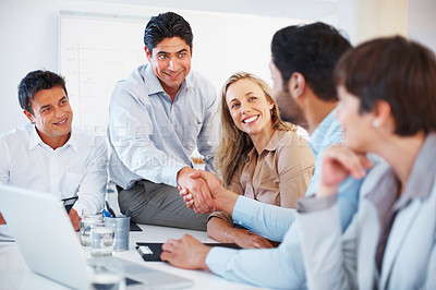 Buy stock photo Business man sitting on table and shaking hands with colleague during meeting
