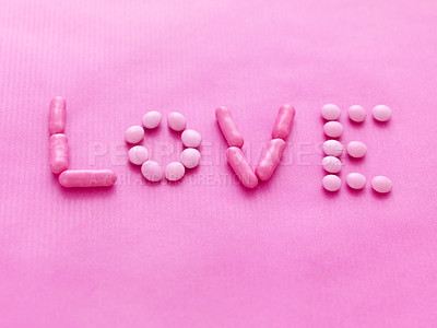 Buy stock photo Word love formed by candy sweets on pink background