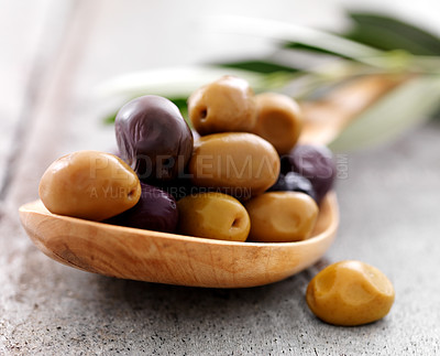 Buy stock photo Green arbequinas and dry black empeltre olives on a spoon