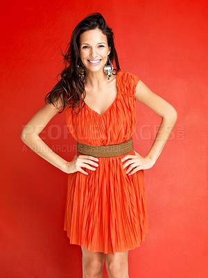 Buy stock photo Portrait of stylish young woman smiling against red background