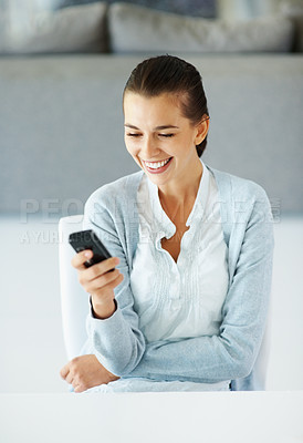 Buy stock photo Woman smiling while holding cell phone