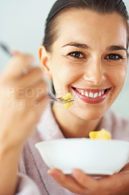 Buy stock photo Smiling woman with bowl of fruit