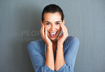 Buy stock photo Smiling woman with hands up to her face