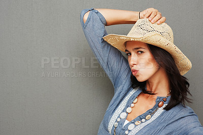 Buy stock photo Pretty woman puckering her mouth while holding cowboy hat