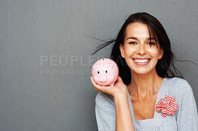 Buy stock photo Happy woman holding up piggy bank