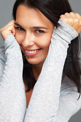 Buy stock photo Closeup of woman smiling in a flirtatious manner with hands on head