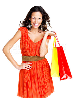 Buy stock photo Portrait of stunning young woman carrying shopping bags against white background