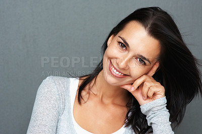 Buy stock photo Pretty young woman leaning on her hand with head tilted