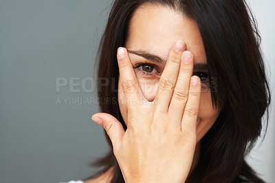 Buy stock photo Closeup of pretty woman peeking out between fingers