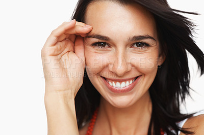 Buy stock photo Pretty woman holding hand to face and smiling