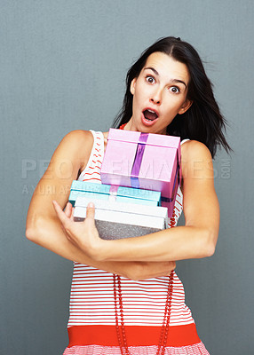 Buy stock photo Surprised pretty woman holding gifts in her arms