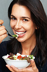 Happy woman holding salad