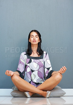 Buy stock photo Pretty woman in lotus position meditating