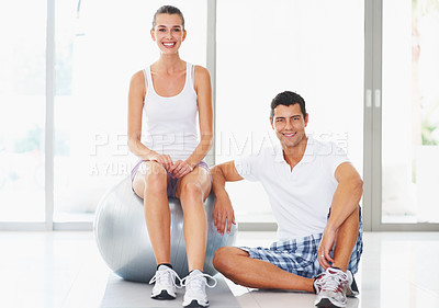 Buy stock photo Portrait of happy young woman and trainer with fitness ball