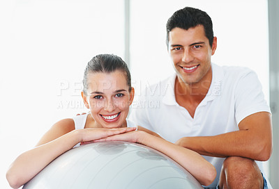 Buy stock photo Young woman and fitness trainer with an exercise ball taking a well-deserved break - copyspace