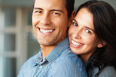 Buy stock photo Closeup of cheerful young couple smiling together