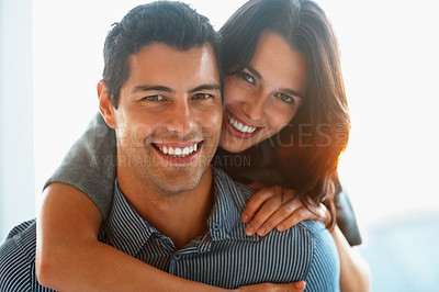Buy stock photo Closeup of pretty young woman hugging her boyfriend from behind