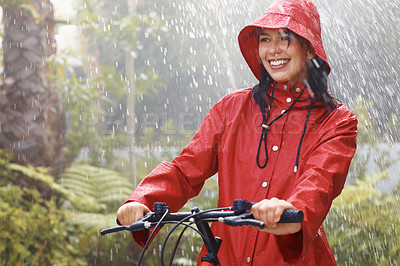 Buy stock photo Portrait of happy young woman riding bicycle and smiling