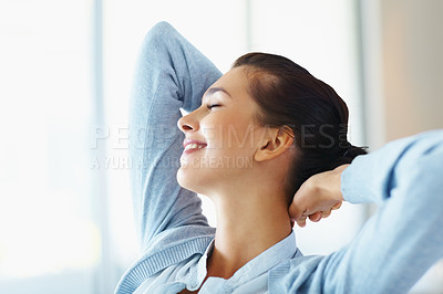 Buy stock photo Closeup of smiling woman relaxing with hands behind head