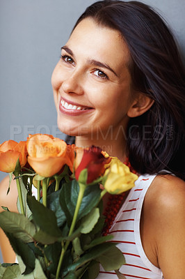 Buy stock photo Closeup of an attractive woman holding a bunch of fresh roses