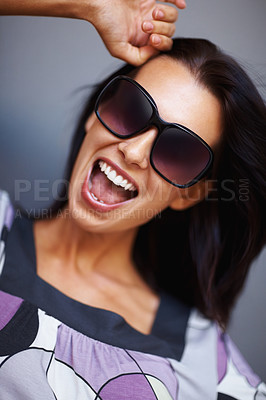 Buy stock photo Crazy young woman in sunglasses on gray background