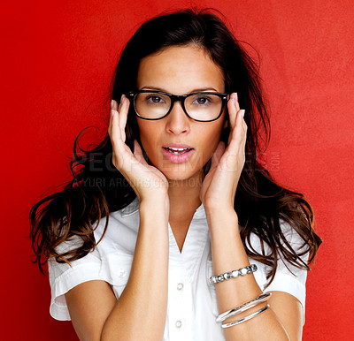 Buy stock photo Portrait of beautiful young woman wearing glasses against red background