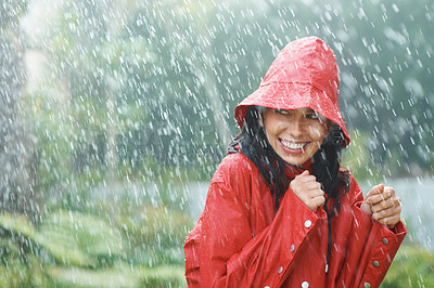 Buy stock photo Pretty young female in red raincoat enjoying rainy season