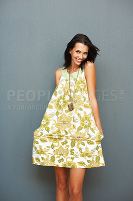 Buy stock photo Portrait of beautiful young woman posing by holding dress