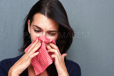 Buy stock photo Portrait of young woman with handkerchief wiping her nose