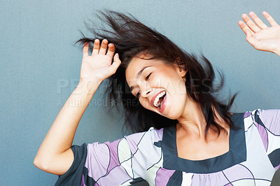 Buy stock photo Beautiful young woman dancing against the wall