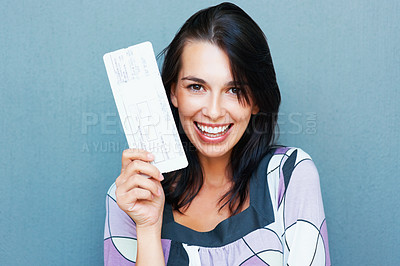 Buy stock photo Closeup portrait of smiling young woman holding boarding pass