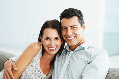 Buy stock photo Portrait of cute young couple embracing and smiling