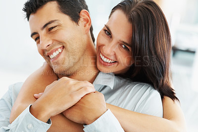 Buy stock photo Portrait of young woman hugging her boyfriend from behind