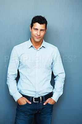 Buy stock photo Portrait of handsome man posing with hands in pockets