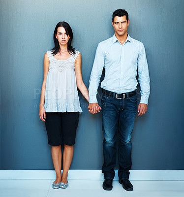 Buy stock photo Full length of young confident business couple holding hands