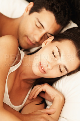 Buy stock photo Portrait of young couple sleeping in bed