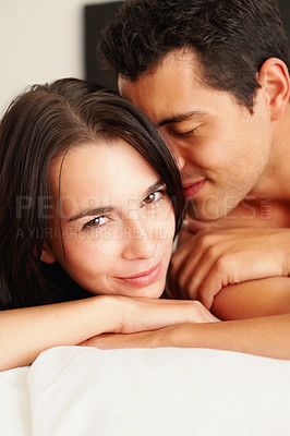 Buy stock photo Young man passionately kissing his girlfriend