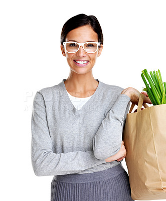 Buy stock photo Portrait of beautiful young woman holding a paper grocery bag against white background