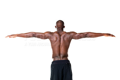 Buy stock photo Rear view of a muscular young man with his arms outstretched against white background