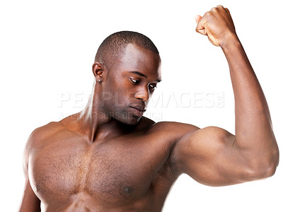 Buy stock photo Portrait of a healthy young man showing his arms against white background