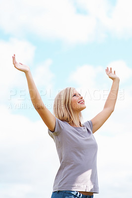 Buy stock photo Young attractive woman with hands raised looking up to the sky