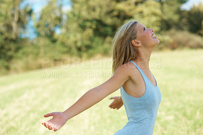Buy stock photo Side view of woman with arms outstretched enjoying at the park