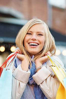 Buy stock photo Closeup of cheerful young woman holding shopping bags