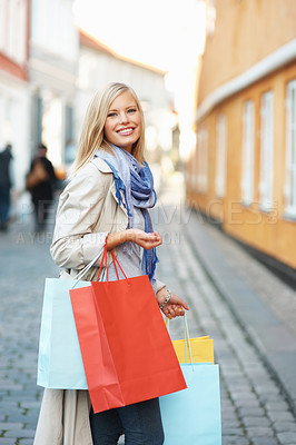 Buy stock photo Pretty young woman with shopping bags in the city