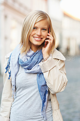 Buy stock photo Happy young woman with her cell phone and smiling