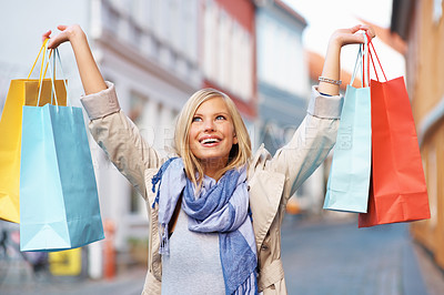 Buy stock photo Excited pretty woman with shopping woman - outdoors