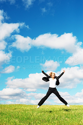 Buy stock photo Portrait of happy business woman jumping in the green field