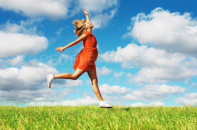Buy stock photo Full length of pretty young woman jumping on green grass