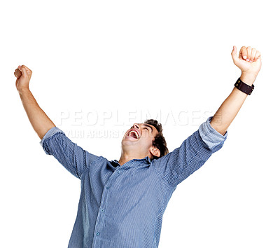 Buy stock photo Portrait of an excited young man celebrating success with raised hand against white background