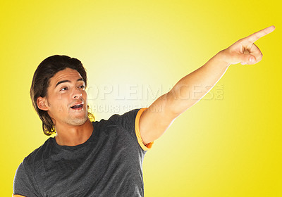 Buy stock photo Handsome man pointing to something